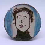 brooch girl with short brown hair