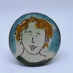 brooch girl with blonde curls