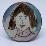 brooch girl with pink jumper